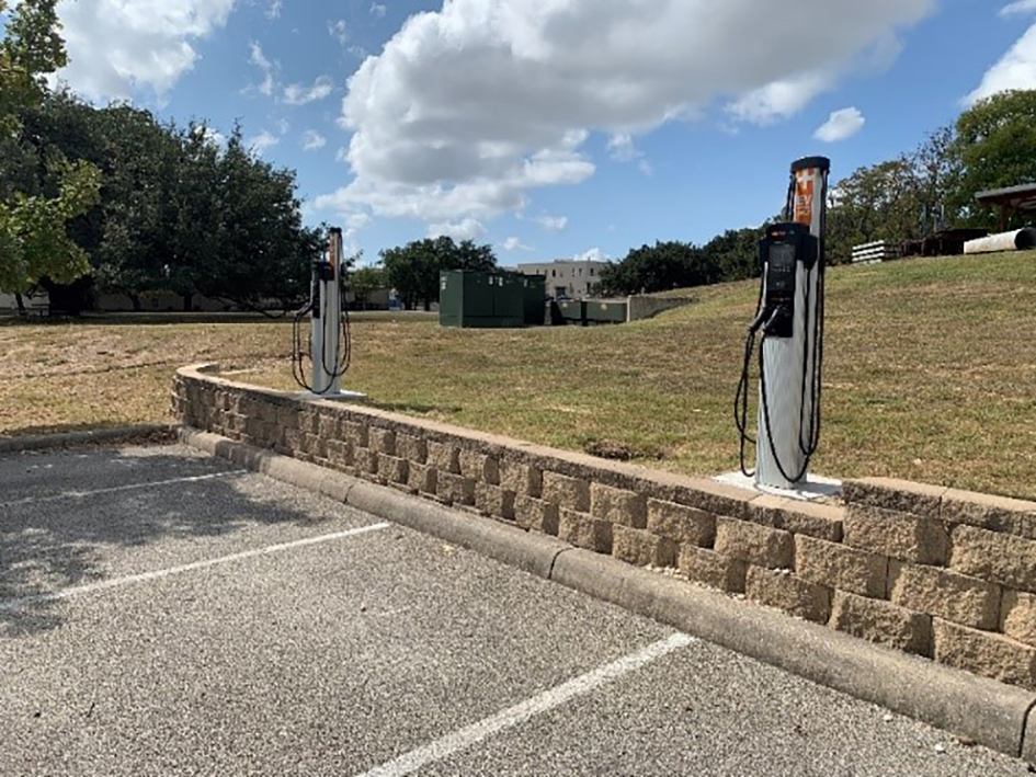 Parking lot photo with two chargepoint stations.