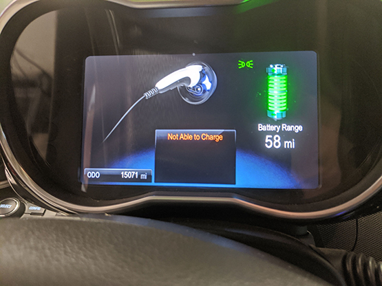 """Car dashboard screen with """"Not Able to Charge"""" message."""