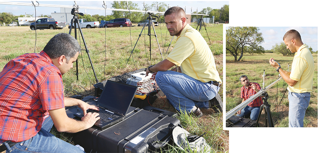 Two men in grassy field calibrating an acoustic array using a laptop