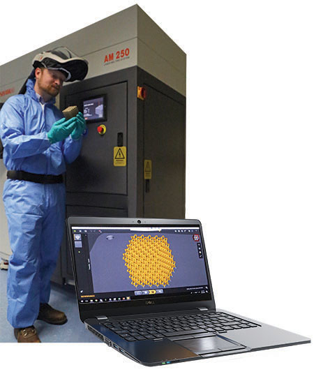 Technician in blue lab suit in front of machinery holding an additive manufacturing product