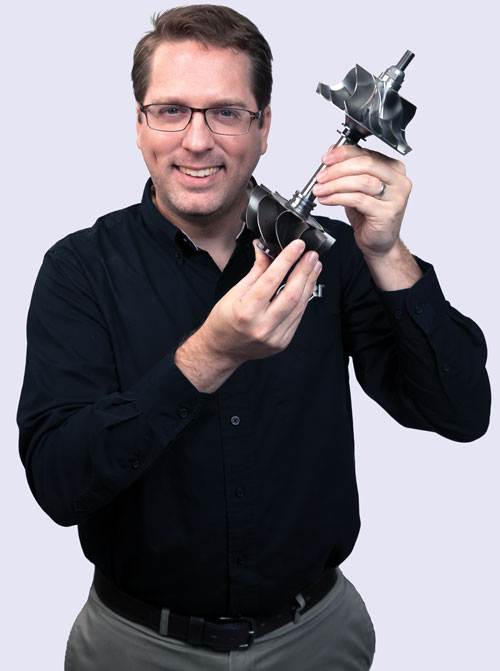 Dr. Tom Allison holding a turbine part