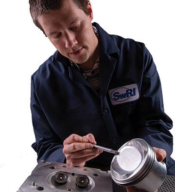 Researcher examines piston