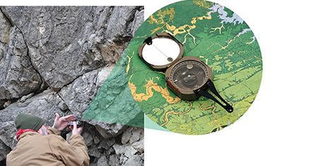 Dr. Kevin Smart using a compass clinometer to measure a rock fault