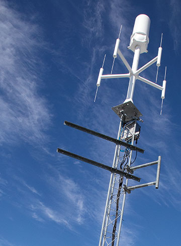 Antenna on a stand with blue sky in the background