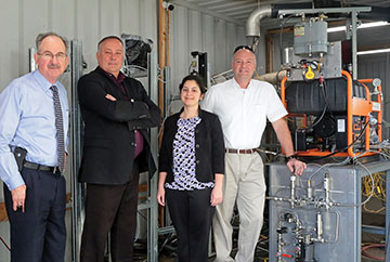 Authors standing next to equipment