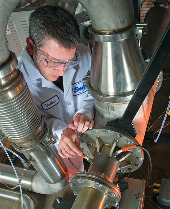 Technician inspecting the ECTO Lab combustor