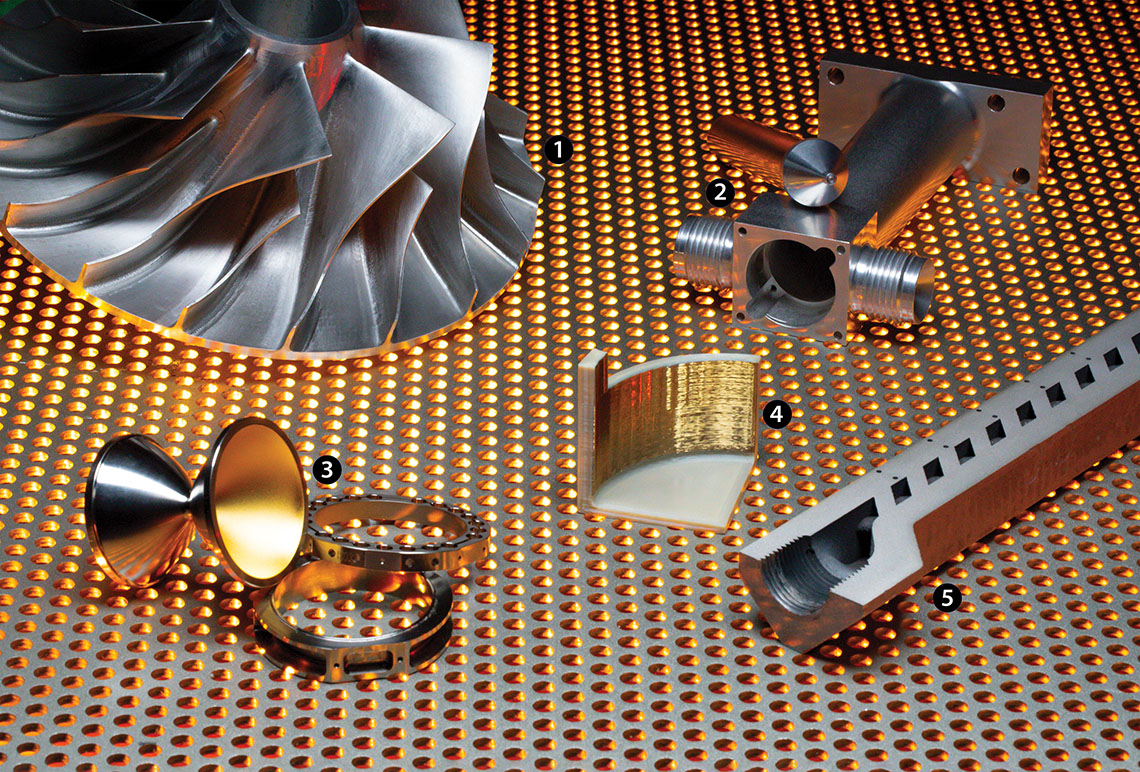 Five examples of metal components laid across a metal screen