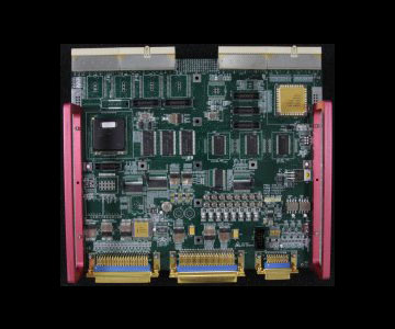 Square circuit board with pink components installed on the left and right