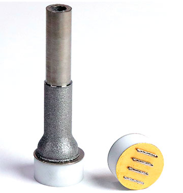titanium tube affixed to a nickel-plated ceramic puck