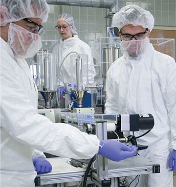 Clean room with scientists wearing protective gear