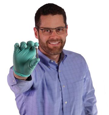 James Noll holding titanium tube
