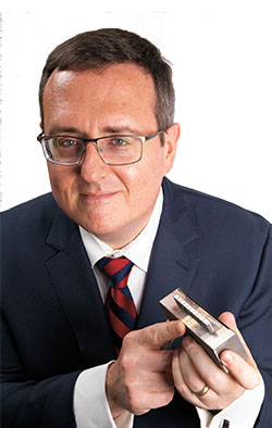 Dr. James Sobotka holding an AM produced product