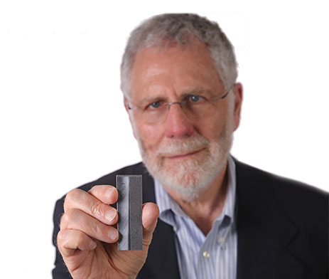 Dr. Jay Fisher holding a product created with additive manufacturing