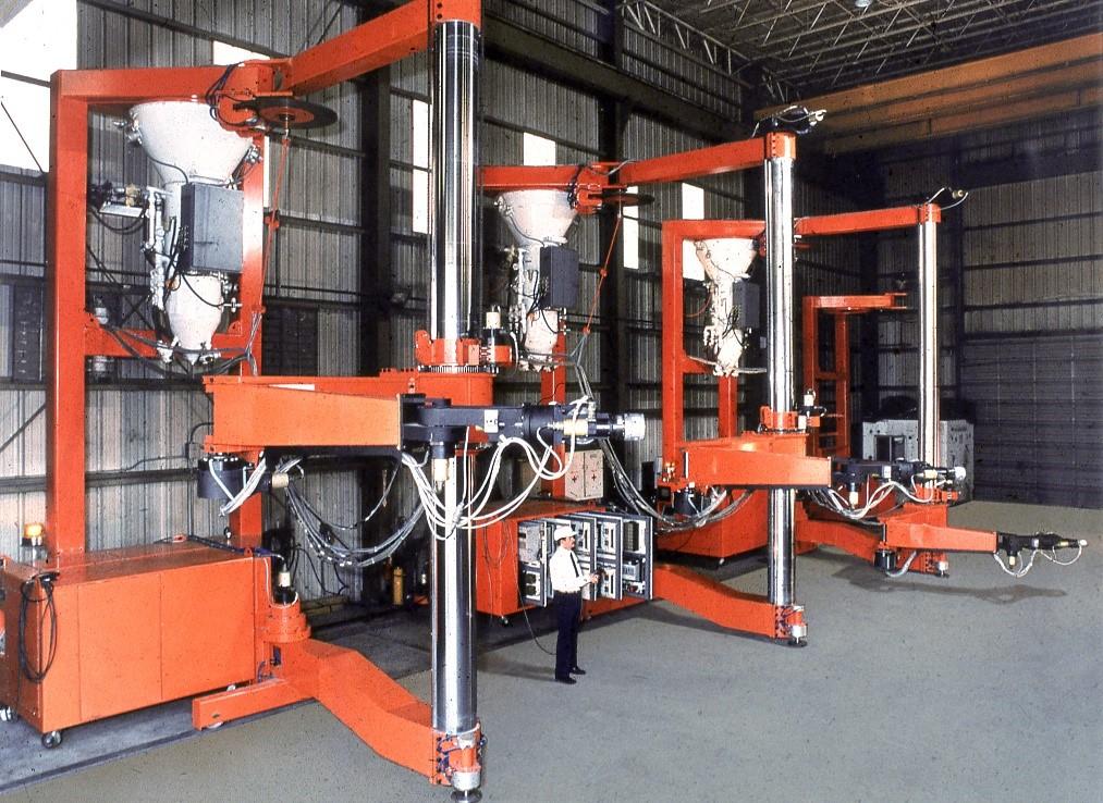 Large orange robot designed to remove aircraft coatings