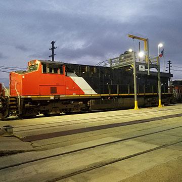 Red locomotive engine on a test track