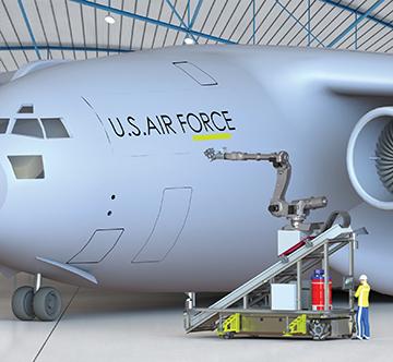 Robotic arm sanding military aircraft