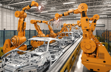 a series of orange robots on either side of an assembly line building automobile frames