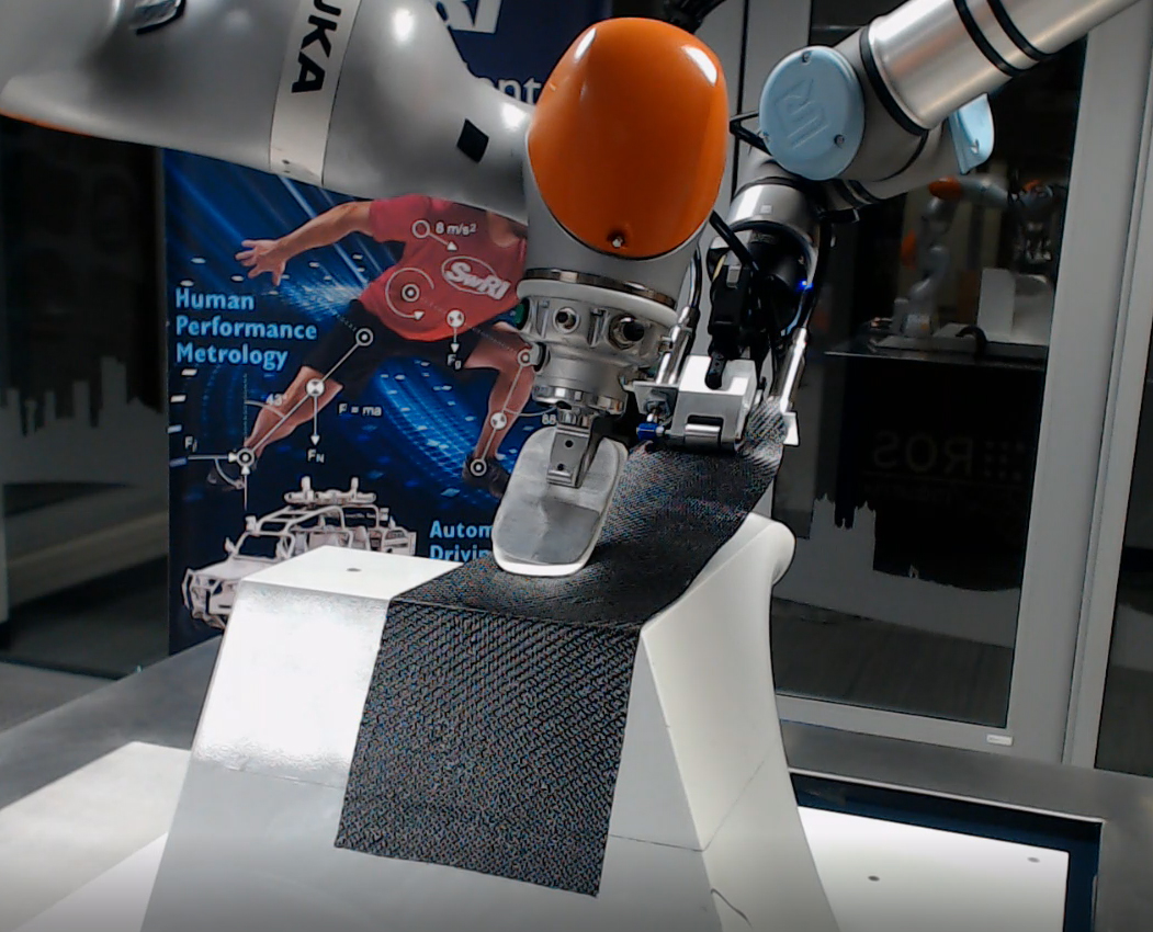 Robotic gripper and consolidation tools performing a prepreg layup test