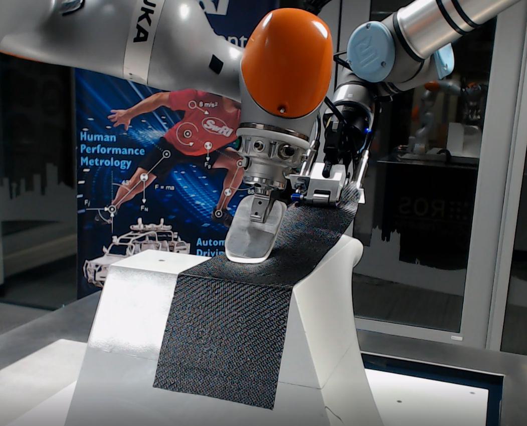 Robotic controller gripping tools to perform prepreg layup