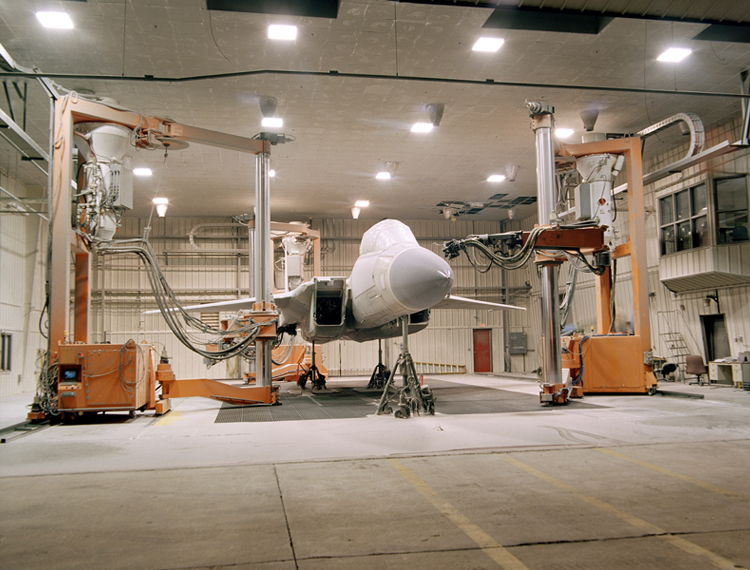 fighter aircraft being stripped of paint by robots