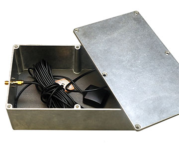 Grey metal box with electronic components inside
