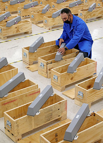 a large number of antennas being placed in wooden boxes