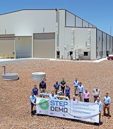 STEP building and team holding a banner saying STEP DEMO