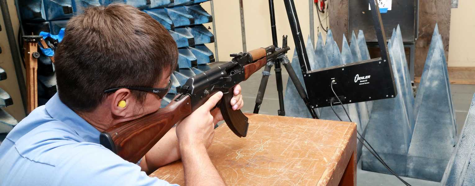 An AK47 is used to shoot bullets thru a radio frequency detection device to determine positions of shooters