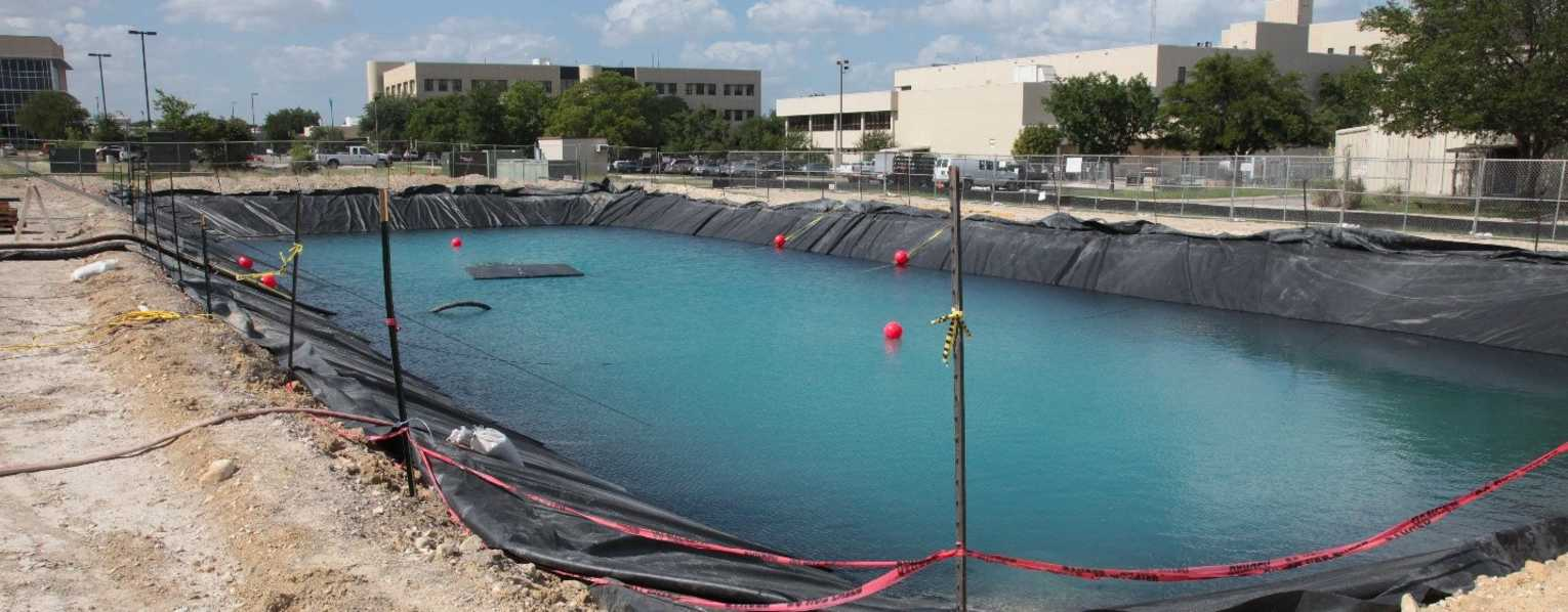Large water filled pool used for pipeline leak detection