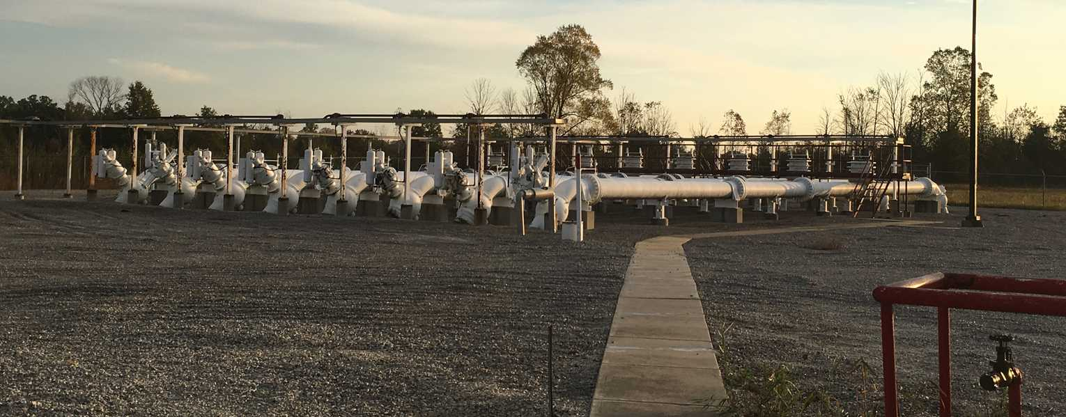 Natural gas pipelines in a field with visible meters