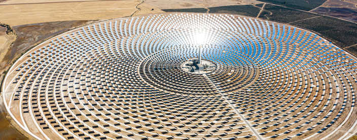 Solar panels in a large thermal circular power plant with the reflection of the sunlight in the panels