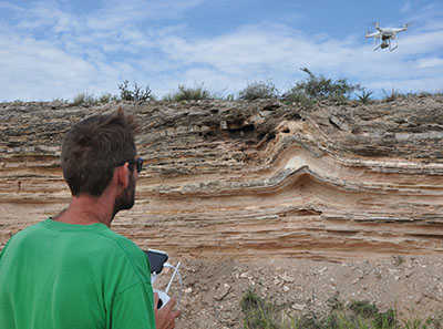 A drone flying over varied terrain