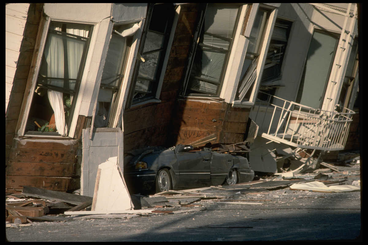Automobile crushed under building after 1989 Loma Prieta earthquake in California