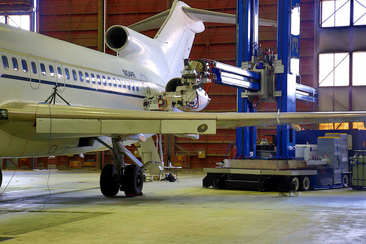 Laser coating removal robot at work on a full-body aircraft in a lab