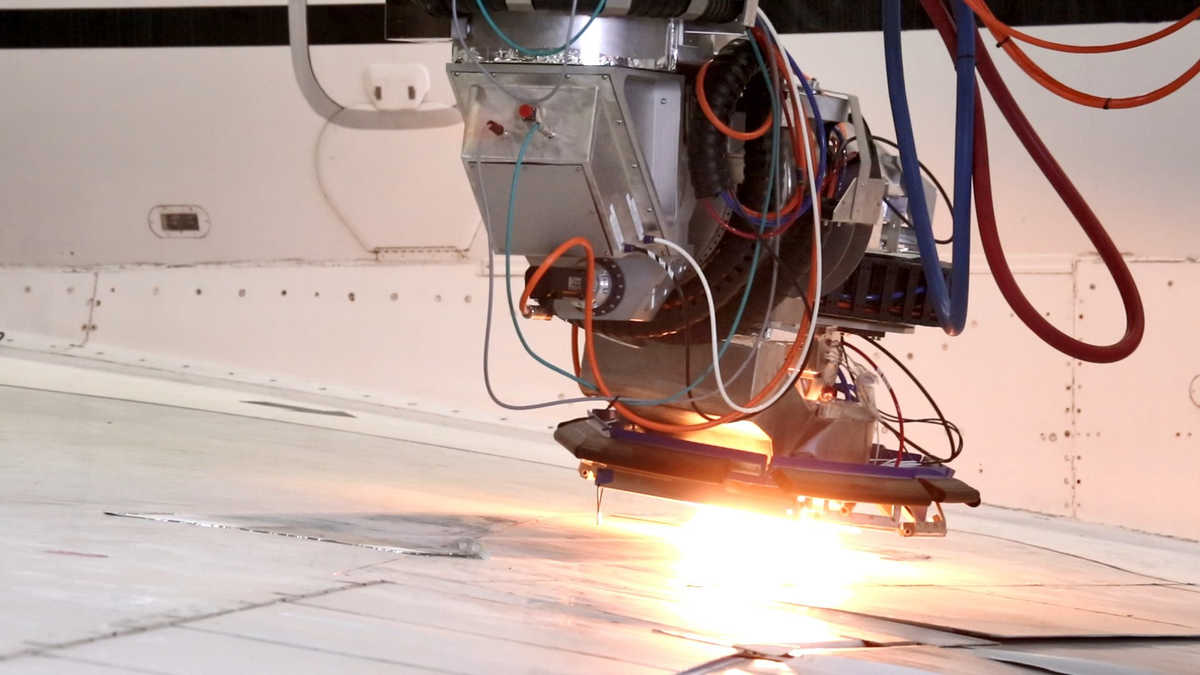 Polygon scanner attached to laser coating robot