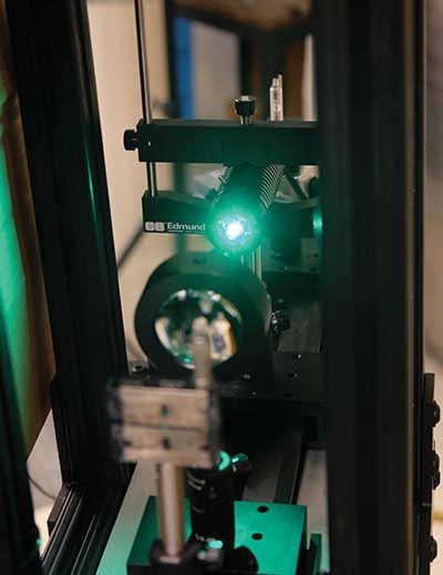 Green laser going through a lens