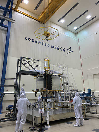 Scientists working on Lucy in a clean room