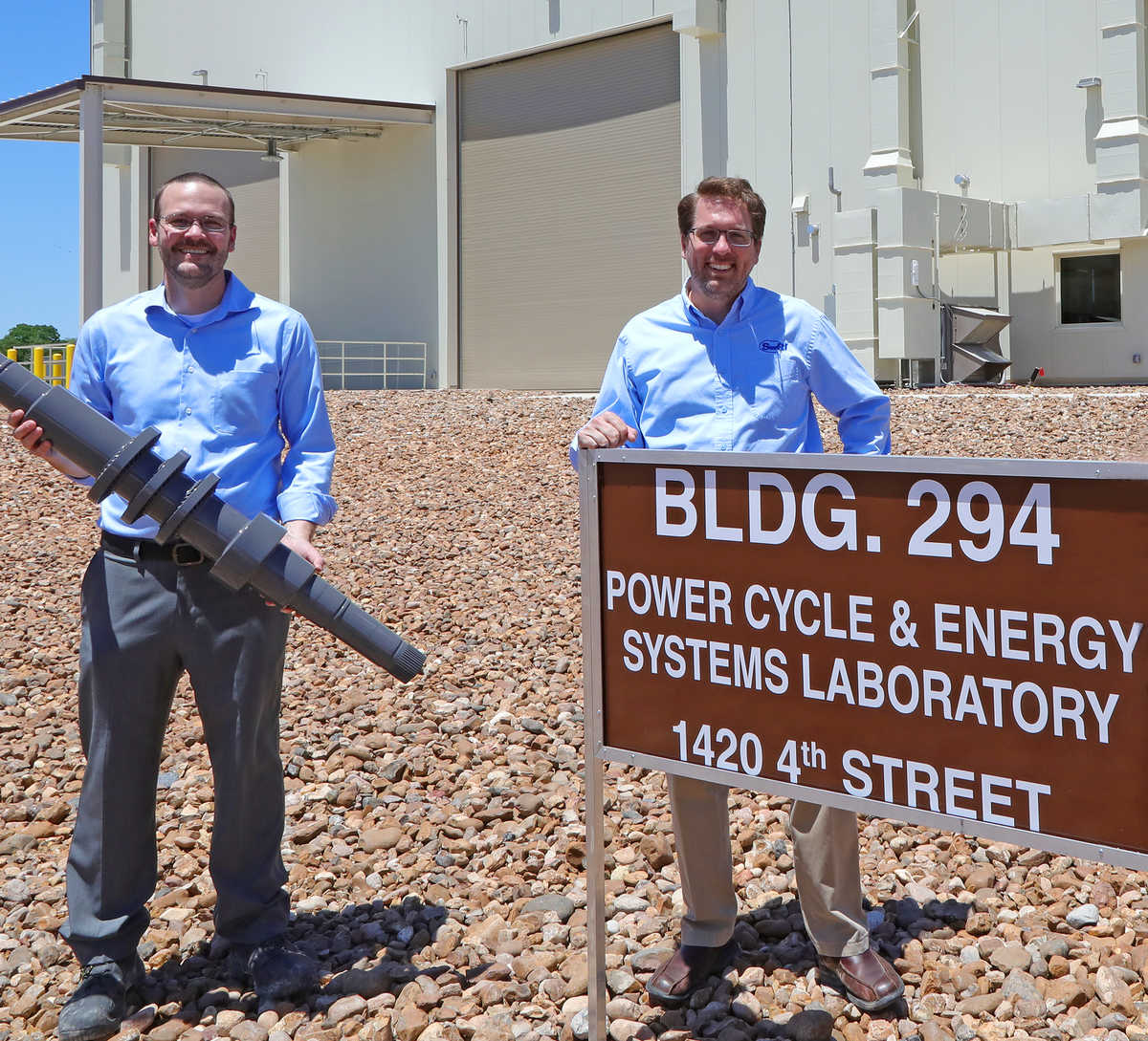SwRI Engineers Dr. Aaron McClung and Dr. Tim Allison standing outside of the STEP pilot plant