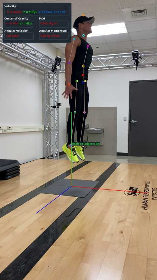 Male athlete jumping with digital markers across his body