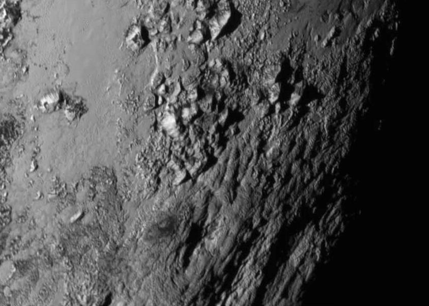 close-up images of a region near Pluto's equator