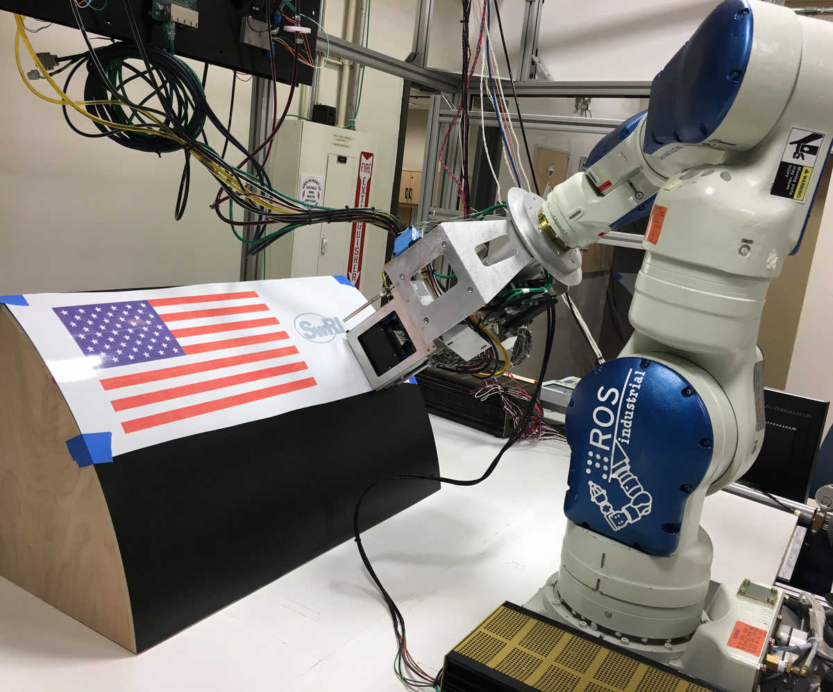 image: large-scale robotic technique for inkjet printing intricate graphics on aircraft and other complicated surfaces