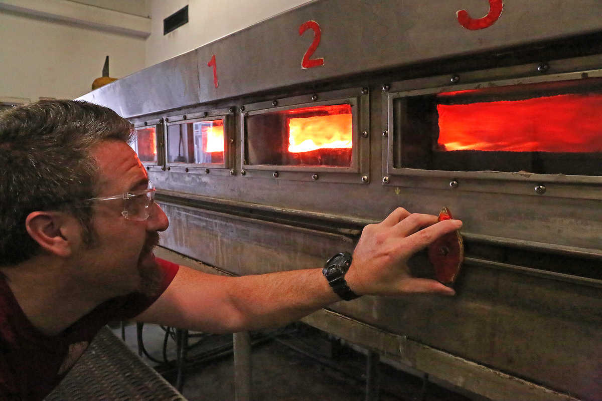 A Fire Technology technician measures the flame spread index during a fire test using standard ASTM E84 in the Steiner Tunnel.