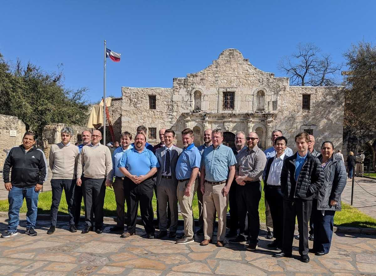 NPSS Consortium members standing in front of the Alamo