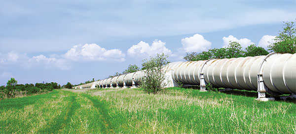 White pipeline across a field