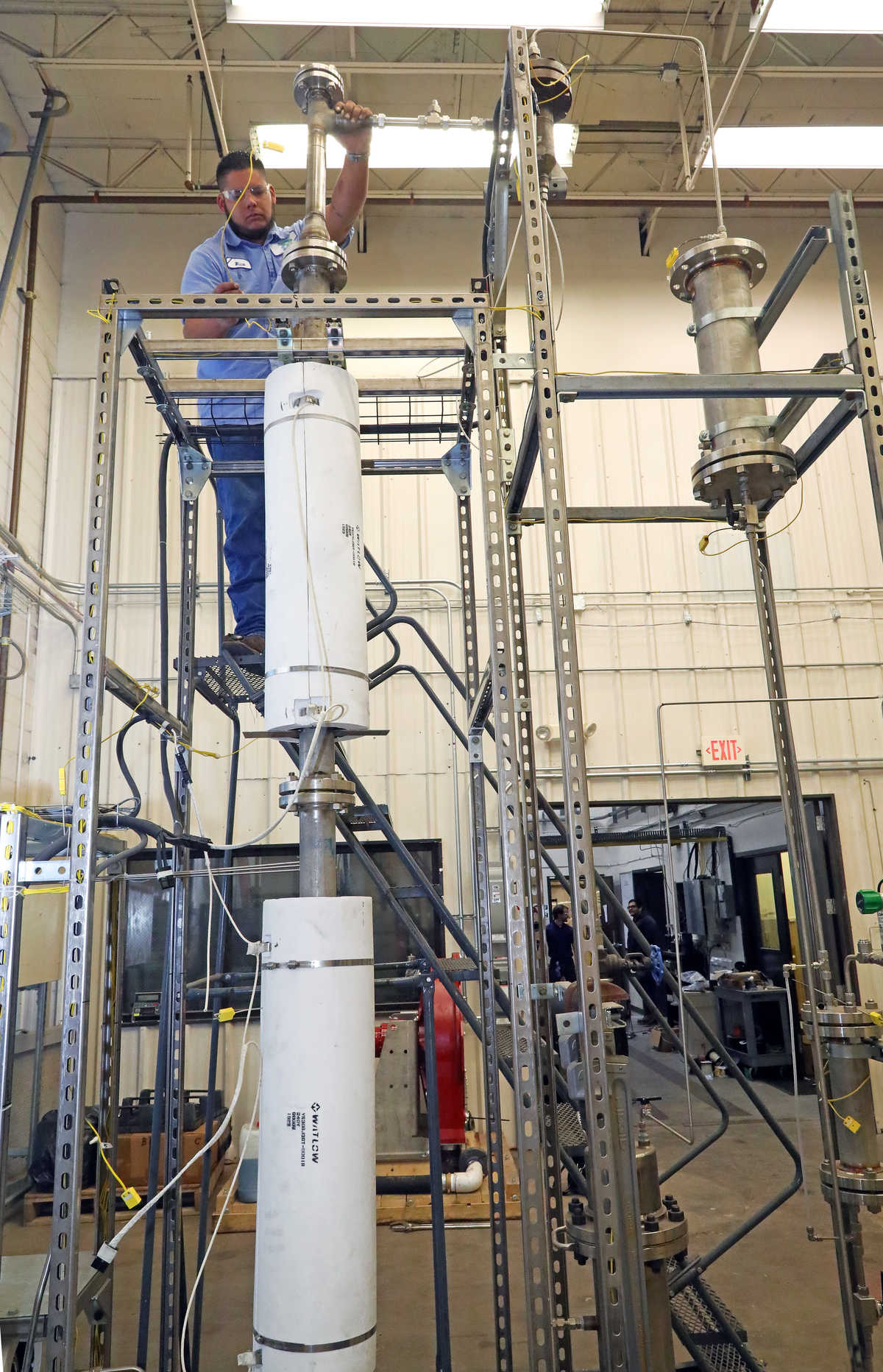 An SwRI engineer setting up equipment for fluidized bed pyrolysis