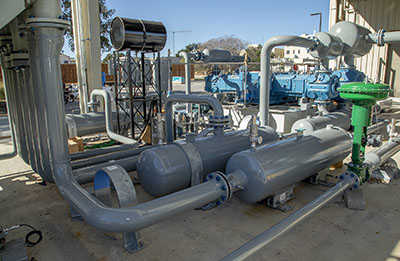 Flow loop system comprised of pipes in an outside lot