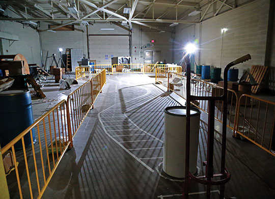 simulated warehouse outfitted with technology to detect the presence of an intruder