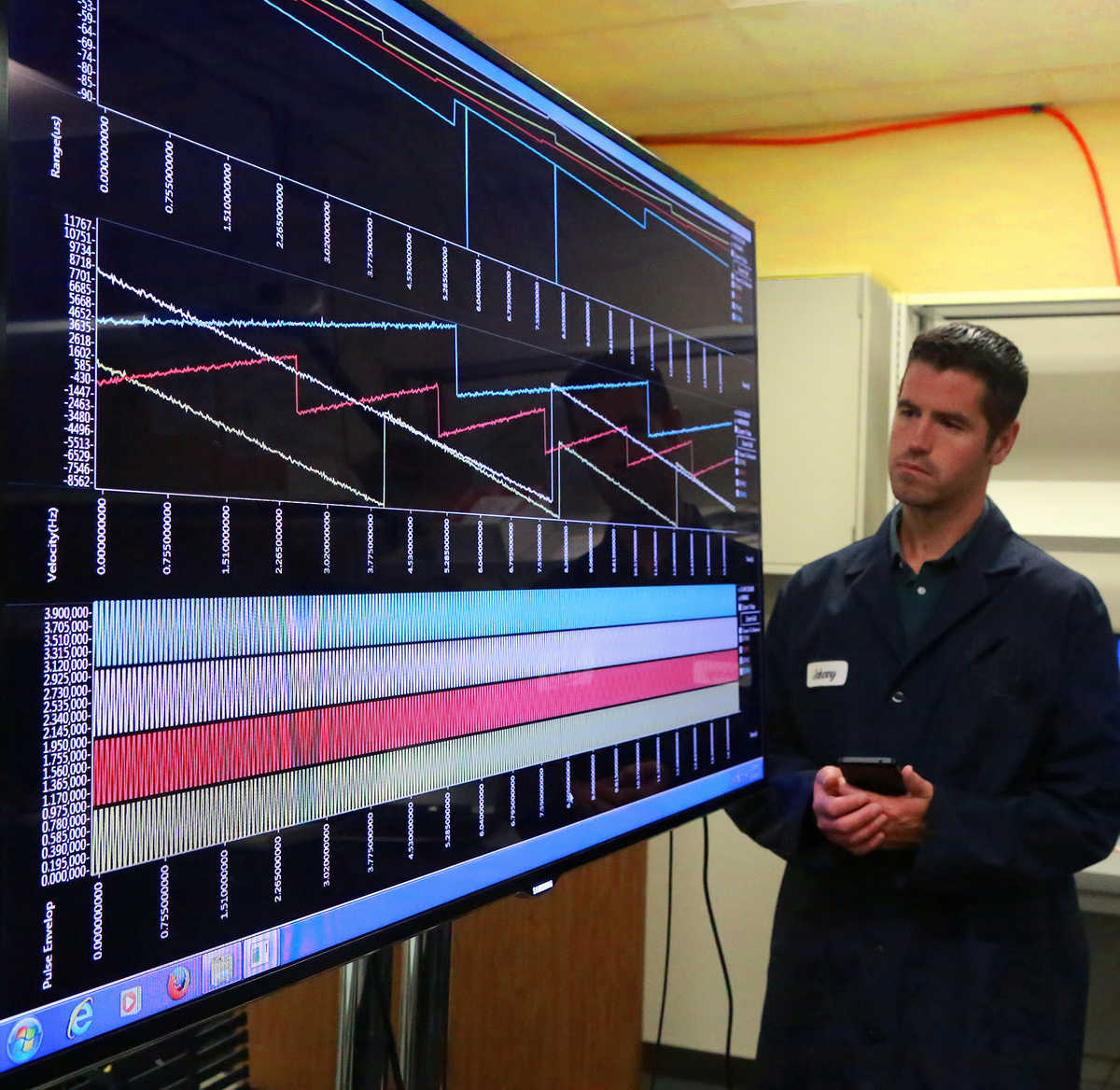 Engineer viewing SPARTA software on a large screen television