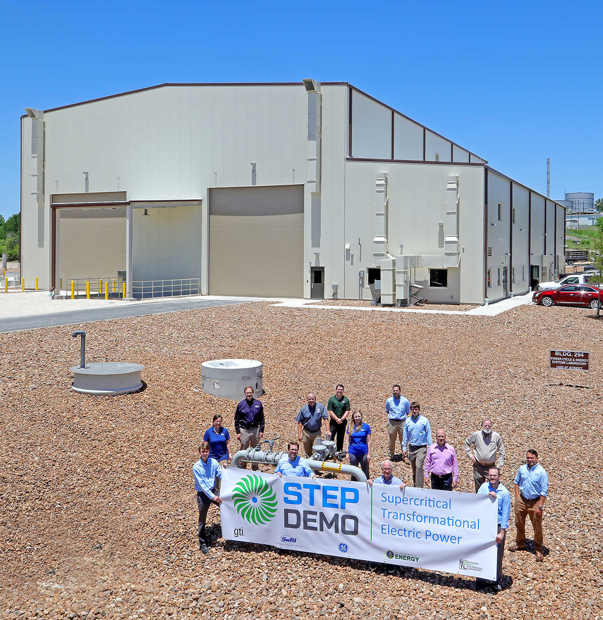 Members of the SwRI and GTI teams standing in front of the completed building housing the STEP pilot plant