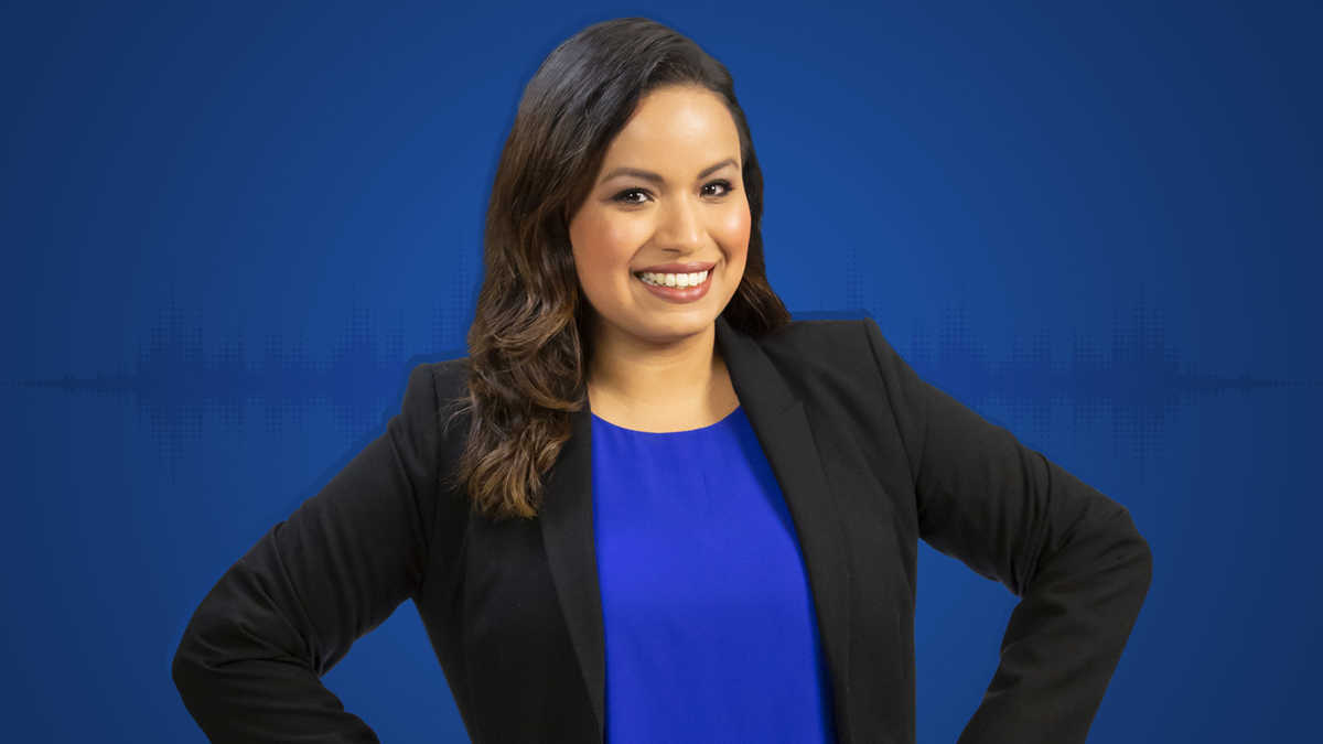 Lisa Peña against a solid blue background
